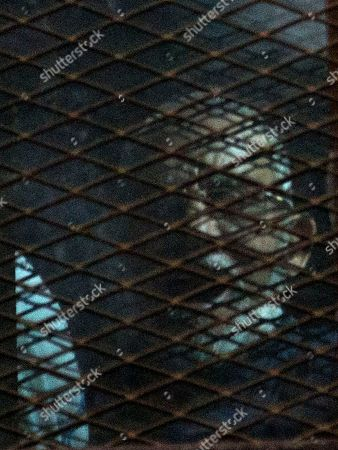 Stock Image of Mohammed Badie Muslim Brotherhood Supreme Guide Mohammed Badie, appears in a courtroom cage, in Cairo, Egypt, . The Egyptian court sentenced four members of the banned Muslim Brotherhood organization to death and 14 to life in prison on Saturday. Badie and his deputy Khairat al-Shater were among those sentenced to life, along with former lawmaker Mohammed el-Beltagy and party head Saad el-Katatni and his deputy, Essam el-Erian. The men were accused of murder and possession of firearms, among other charges. The verdict can be appealed