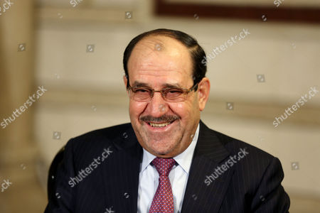 Iraq's Vice President and former Prime Minister Nouri al-Maliki, smiles during an interview with The Associated Press in Baghdad, Iraq, . Al-Maliki denies he is seeking a political comeback despite frequent appearances in local media and a recent high-profile visit to influential neighboring Iran