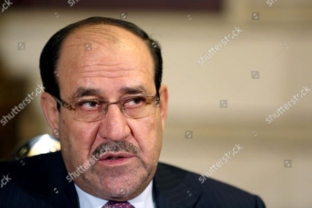 Iraq's Vice President and former Prime Minister Nouri al-Maliki, listens to a question during an interview with The Associated Press in Baghdad, Iraq, . Al-Maliki denies he is seeking a political comeback despite frequent appearances in local media and a recent high-profile visit to influential neighboring Iran