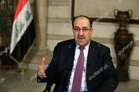 Iraq's Vice President and former Prime Minister Nouri al-Maliki, speaks during an interview with The Associated Press in Baghdad, Iraq, . Al-Maliki denies he is seeking a political comeback despite frequent appearances in local media and a recent high-profile visit to influential neighboring Iran