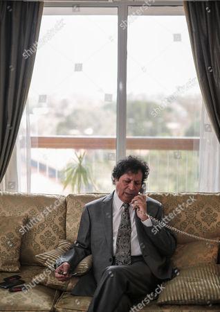 Ahmed Qaddaf al-Dam, cousin of Libya's former president Muammar Gaddafi, speaks on the phone at his apartment, in Cairo, Egypt