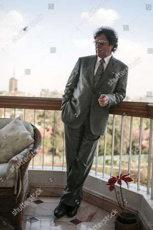 Ahmed Qaddaf al-Dam, cousin of Libya's former president Muammar Gaddafi, poses for a photo at his apartment, in Cairo, Egypt