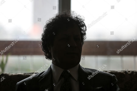A silhouette of Ahmed Qaddaf al-Dam, cousin of Libya's former president Muammar Gaddafi, at his apartment, in Cairo, Egypt