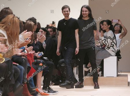 Artistic directors Alexis Martial, right, and Adrien Caillaudaud acknowledge applause after the presentation of Carven's fall-winter 2015-2016 ready-to-wear fashion collection as part of the Paris Fashion Week, in Paris, France