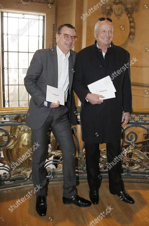French businessmen Olivier Courtin-Clarins, left, and Christian Courtin-Clarins pose before Mugler's ready-to-wear Fall-Winter 2015-2016 fashion collection during the Paris Fashion Week in Paris, France