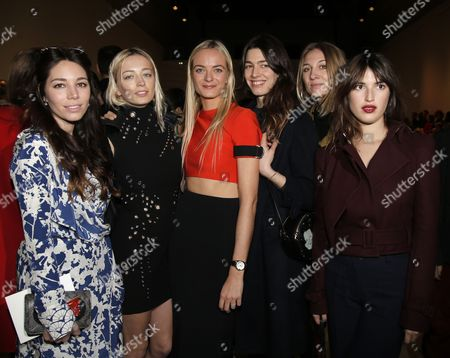 Stock Photo of British singer Caroline Vreeland, second left, France's Virginie Courtin-Clarins, third left, and other guests pose before Mugler's ready-to-wear Fall-Winter 2015-2016 fashion collection during the Paris Fashion Week in Paris, France