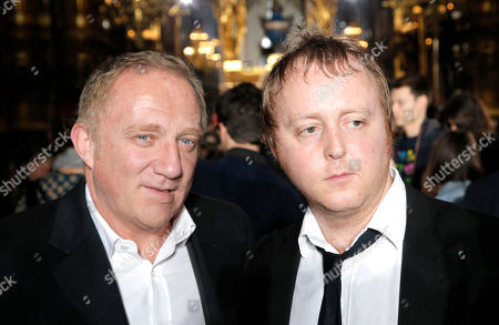 From left, French businessman Francois-Henri Pinault and James McCartney, son of Paul McCartney pose for photographers prior to Stella McCartney's ready to wear fall-winter 2015-2016 fashion collection during Paris Fashion Week, Paris, France