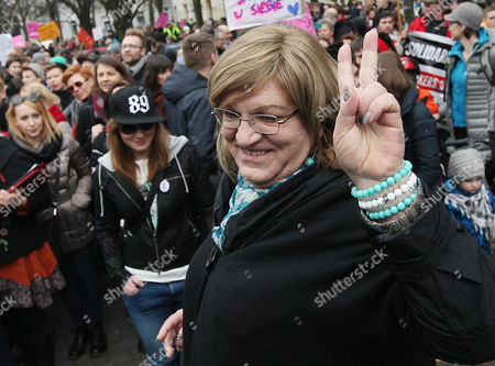 Stock Image of Presidential candidate Anna Grodzka of the Green Party, who is Poland's first transsexual lawmaker, makes a victory sign as she attends an International Woman's Day rally in Warsaw, Poland