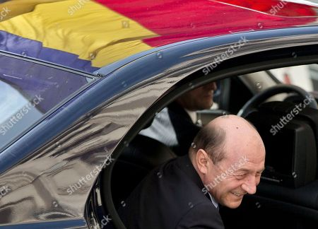 Former Romanian President Traian Basescu arrives at the prosecutor's office in Bucharest, Romania, . Prosecutors have informed Basescu he is under a criminal investigation for making threatening remarks to Senator Gabriela Vranceanu Firea, a political rival. The investigation did not start while Basescu was still in office because he had immunity from prosecution as president