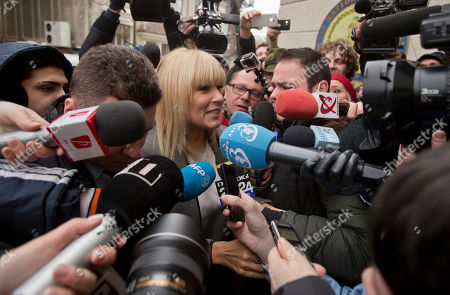On, media surrounds Elena Udrea a 41-year-old Romanian politician who gained notoriety due to her close relationship with Traian Basescu, Romania's president from 2004 to 2014, as she arrives at the anti-corruption prosecutor's office in Bucharest, Romania. Udrea, a former Romanian tourism minister and presidential candidate was detained for 24 hours late Tuesday after she entered the anti-corruption prosecutor's office to answer charges of money laundering and influence peddling
