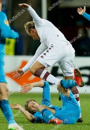 Maxi Lopez, Anatoliy Tymoshchuk Torino's Maxi Lopez, above, clashes with Zenit's Anatoliy Tymoshchuk during the first leg, round of 16 Europa League match between Zenit St.Petersburg and Torino FC in St.Petersburg, Russia