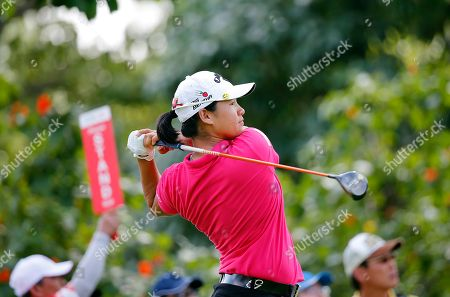 Yani Tseng of Taiwan tees off on the ninth hole during the final round of the HSBC Women's Champions golf tournament on in Singapore