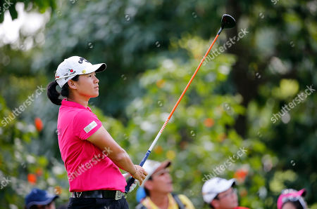 Yani Tseng of Taiwan watches her shot after teeing off on the ninth hole during the final round of the HSBC Women's Champions golf tournament on in Singapore