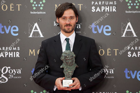 "Carlos Marques Marcet Spanish director Carlos Marques Marcet holds the Goya trophy after winning in best new director for the film ""10.000 Km"" at the Goya Film Awards Ceremony in Madrid, Spain"