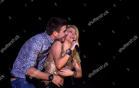 """Shakira, Gerard Pique Colombia's pop star singer Shakira performs with FC Barcelona Gerard Pique during her """"The Sun Comes Out World Tour"""" concert in Barcelona, Spain. Shakira says she has given birth to a boy her second child with partner, Spanish football star Gerard Pique. In a statement on her official Twitter account, Shakira, 37, said Sasha Pique Mebarak was born Thursday at 9.54 p.m. in Barcelona, Spain"""