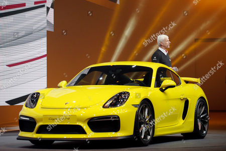 Chief Executive Officer of Porsche AG Matthias Muller introduces the new Porsche Cayman GT4 during a preview show of Volkswagen Group, as part of the 85th Geneva International Motor Show, Switzerland