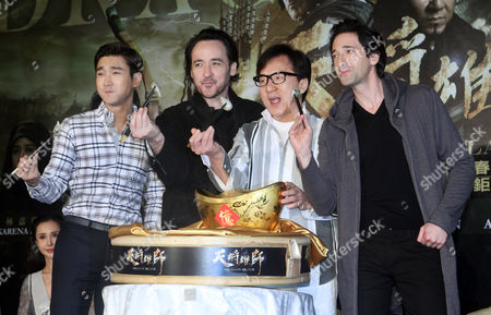 "Jackie Chan, John Cusack, Adrien Brody, Siwon Choi U.S. actor Adrien Brody, from right, Hong Kong actor Jackie Chan, U.S. actor John Cusack and South Korean actor Siwon Choi taste dumplings during an event to promote their new movie ""Dragon Blade"" in Taipei, Taiwan"