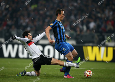 Pedro Franco, Tom De Sutter Tom De Sutter of Club Brugge, right, and Pedro Franco of Besiktas fight for the ball during their Europa League Round of 16 second leg soccer match between Besiktas and Club Brugge at Ataturk Olimpiyat Stadium in Istanbul, Turkey