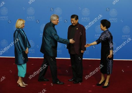 Stephen Harper, Laureen Harper, Xi Jinping, Peng Liyuan Canadian Prime Minister Stephen Harper, second left, and his wife, Laureen, are greeted by Chinese President Xi Jinping and his wife, Peng Liyuan, for the dinner hosted by Xi for APEC leaders at the Beijing National Aquatics Center in Beijing