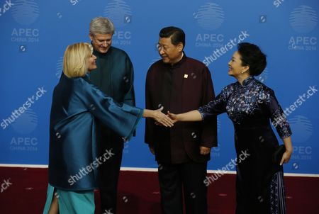 Stephen Harper, Laureen Harper, Xi Jinping, Peng Liyuan Canadian Prime Minister Stephen Harper, second left, and his wife, Laureen, left, are greeted by Chinese President Xi Jinping and his wife, Peng Liyuan, for the dinner hosted by Xi for APEC leaders at the Beijing National Aquatics Center in Beijing