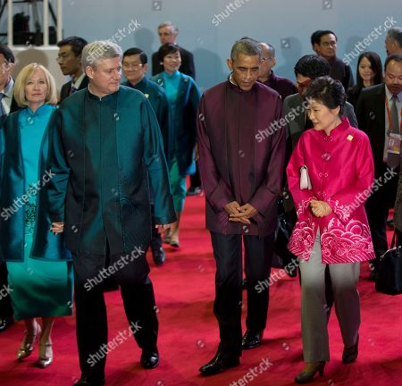 Barack Obama, Xi Jinping, Park Geun-hye, Stephen Harper, Laureen Harper U.S. President Barack Obama, second right, walks with South Korean President Park Geun-hye, right, and Canadian Prime Minister Stephen Harper, second left, and his wife, Laureen, at the Asia-Pacific Economic Cooperation (APEC) Summit family photo, in Beijing