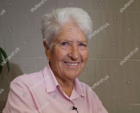 """Dawn Fraser Australian Olympic swimming great Dawn Fraser smiles during an interview in Tokyo. Fraser has """"unreservedly apologized"""", for her comments in which she suggested that that tennis stars Nick Kyrgios and Bernard Tomic should set a better example or go back to where their parents came from. Fraser, who won eight Olympic medals including four golds, was speaking in an interview on Australian television Tuesday, when asked about recent petulant behavior by Kyrgios and Tomic"""