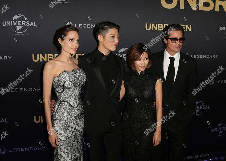 "Angelina Jolie Mayavi Melody Ishihara Brad Pitt Movie star Angelina Jolie left, director of ""Unbroken"", poses for photos with Mayavi, second left, Melody Ishihara, center, and Brad Pitt, right, at the World Premiere of the film in Sydney, Australia"