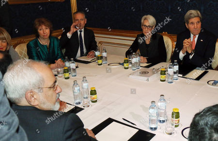 Mohammad Javad Zarif, John Kerry, Catherine Ashton Iranian Foreign Minister Mohammad Javad Zarif, front left, former EU foreign policy chief Catherine Ashton, rear second left, and U.S. Secretary of State John Kerry, right, wait for the start of closed-door nuclear talks on Iran in Vienna, Austria