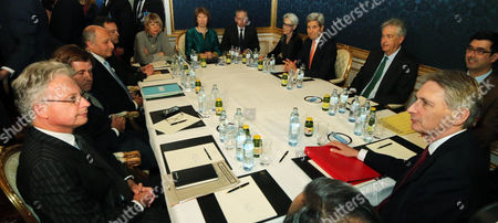 John Kerry, Catherine Ashton, Laurent Fabius, Philip Hammond French Foreign Minister Laurent Fabius, sitting third left, former EU foreign policy chief Catherine Ashton, rear center, U.S. Secretary of State John Kerry, fourth right, and British Foreign Secretary Philip Hammond wait for the start of closed-door nuclear talks on Iran in Vienna, Austria
