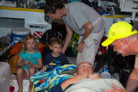 Athlete tries for record breaking swim in the Bahamas Australian ultra-marathon swimmer Chloe McCardel is comforted by her husband Paul McQueeney, right, while Lily Hope, 6, and Luke Hope, 4, along with their Mother Michelle Lakin Hope, get the chance to meet McCardel as she rests on a boat off the Nassau coastline early after completing her world record marathon swim attempt. McCardel was severely dehydrated and fatigued, in addition to having suffered multiple jellyfish bites and the affects of sunstroke during the 128 kilometer (80 mile) swim from the island of Eleuthera to New Providence, Bahamasa