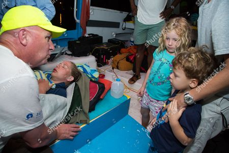 Athlete tries for record breaking swim in the Bahamas Australian ultra-marathon swimmer Chloe McCardel is comforted by her husband Paul McQueeney, left while Lily Hope, 6, and Luke Hope, 4, get the chance to visit with McCardel as she rests on a boat off the Nassau coastline early after completing her world record marathon swim attempt. McCardel was severely dehydrated and fatigued, in addition to having suffered multiple jellyfish bites and the affects of sunstroke during the 128 kilometer (80 mile) swim from the island of Eleuthera to New Providence