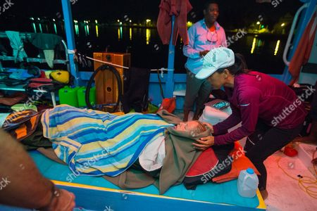 Athlete tries for record breaking swim in the Bahamas Australian ultra-marathon swimmer Chloe McCardel is wrapped in blankets by an unidentified helper, as she rests on a boat off the Nassau coastline early after completing her world record marathon swim attempt. McCardel was severely dehydrated and fatigued, in addition to having suffered multiple jellyfish bites and the affects of sunstroke during the 128 kilometer (80 mile) swim from the island of Eleuthera to New Providence, Bahamas