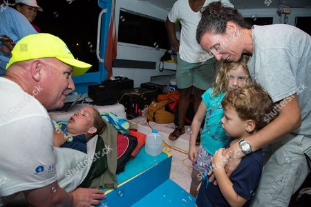 Athlete tries for record breaking swim in the Bahamas Australian ultra-marathon swimmer Chloe McCardel is comforted by her husband Paul McQueeney, left while Lily Hope, 6, and Luke Hope, 4, along with their Mother Michelle Lakin Hope, get the chance to meet McCardel as she rests on a boat off the Nassau coastline early after completing her world record marathon swim attempt. McCardel was severely dehydrated and fatigued, in addition to having suffered multiple jellyfish bites and the affects of sunstroke during the 128 kilometer (80 mile) swim from the island of Eleuthera to New Providence, Bahamasa