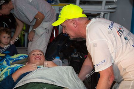 Athlete tries for record breaking swim in the Bahamas Australian ultra-marathon swimmer Chloe McCardel is comforted by her husband Paul McQueeney, right, as she rests on a boat off the Nassau coastline early after completing her world record marathon swim attempt. McCardel was severely dehydrated and fatigued, in addition to having suffered multiple jellyfish bites and the affects of sunstroke during the 128 kilometer (80 mile) swim from the island of Eleuthera to New Providence, Bahamas