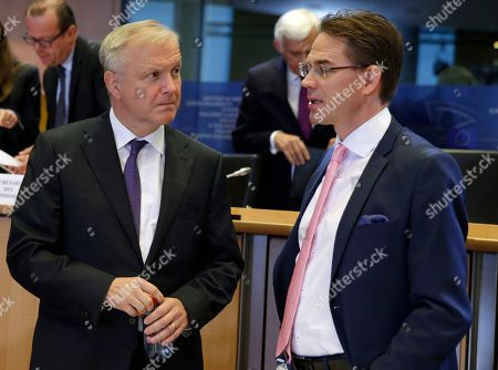 Jyrki Katainen, Olli Rehn European Union Commissioner designate for Jobs, Growth, Investment and Competitiveness Jyrki Katainen, right, talks with acting EU Commissioner for Economic and Monetary Affairs Olli Rehn, prior to a hearing at the Committee on Economic and Monetary Affairs, the Committee on Employment and Social Affairs, the Committee on Industry, Research and Energy and the Committee on Transport and Tourism and the Committee on Regional Development, at the European Parliament in Brussels, on
