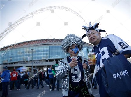 Andy and Linda Mendoza, from Ft. Worth, Texas, pose outside of Wembley Stadium before the NFL football game between the Dallas Cowboys and the Jacksonville Jaguars in London