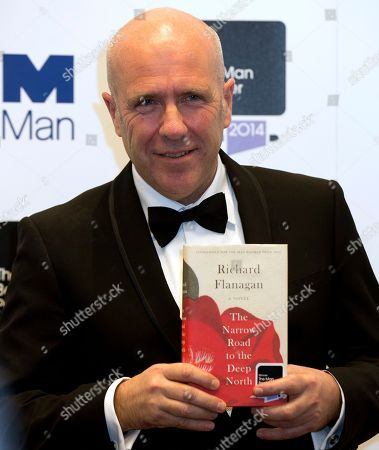 Winner of the Man Booker for fiction 2014 Australian author Richard Flanagan, author of 'The Narrow Road to the Deep North', poses for the camera after winning the prize at the Guildhall in London