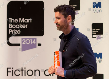 Stock Image of Man Booker prize 2014 nominee US author Joshua Ferris holds his book 'To Rise Again at a Decent Hour' during a photocall for the Man Booker Prize for fiction 2014 at the Royal Festival Hall in London, . The winner will be announced in London on Tuesday