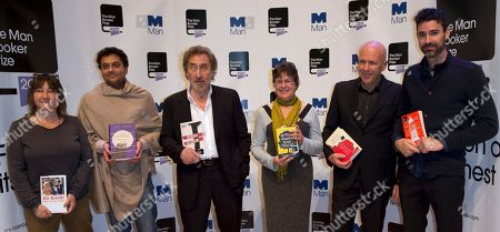 Nominees for the 2014 Man Booker prize for fiction, each holding their book from the left, British author Ali Smith, 'How To Be Both', British author Neel Mukherjee, 'The Lives of Others', British author Howard Jacobson 'J', US author Karen Joy Fowler, 'We Are All Completely Beside Ourselves', Australian author Richard Flanagan, 'The Narrow Road to the Deep North', and US author Joshua Ferris, 'To Rise Again at a Decent Hour', pose for the cameras during a photo call at the Royal Festival Hall in London