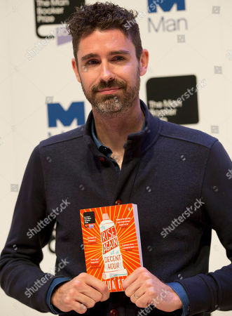 Stock Picture of Man Booker prize 2014 nominee US author Joshua Ferris holds his book 'To Rise Again at a Decent Hour' during a photocall for the Man Booker Prize for fiction 2014 at the Royal Festival Hall in London, . The winner will be announced in London on Tuesday
