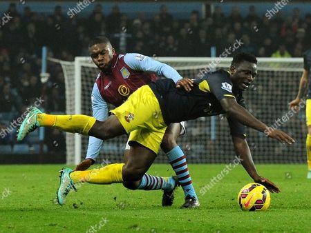 Aston Villa's Charles N'Zogbia, left, tackles Southampton's Victor Wanyama during the English Premier League soccer match between Aston Villa and Southampton at Villa Park, Birmingham, England