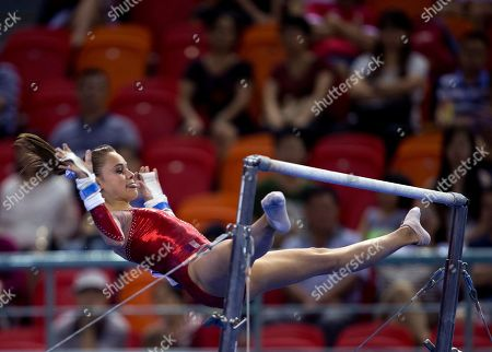 Claire Martin Claire Martin of France leaps from the uneven bars as she competes in the women's qualifying round of the Artistic Gymnastics World Championships at the Guangxi Gymnasium in Nanning, capital of southwest China's Guangxi Zhuang Autonomous Region