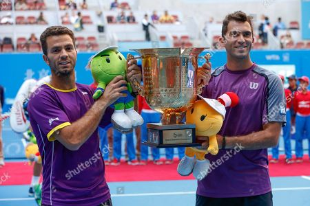 Horia Tecau, Jean-Julien Rojer Horia Tecau, right, of Romania and Jean-Julien Rojer of the Netherlands lift their trophy after winning over French pair of Michael Llodra and Nicolas Mahut during the men's doubles final at China Open tennis tournament at the National Tennis Stadium in Beijing, China