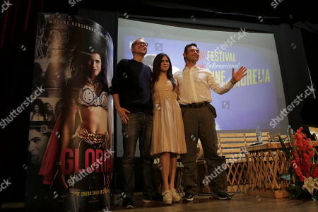 "Mexican actress Sofia Espinosa, center, stands with Swiss film director Christian Keller,left, and Mexican producer Matthias Ehrenberg at a news conference to promote the film ""Gloria"" during the Morelia Film Festival in Morelia, Mexico, . The film is based on the life of Mexican pop star Gloria Trevi"