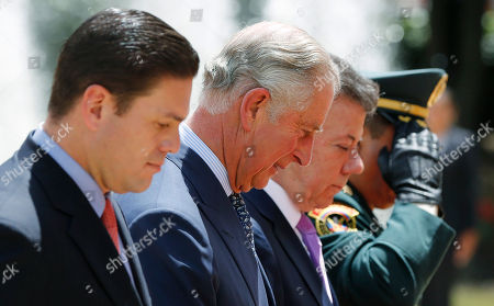 Prince Charles, Juan Manuel Santos, Juan Carlos Pinzon, Gen. Juan Pablo Rodriguez Britain's Prince Charles, second from left, stands between Colombia's President Juan Manuel Santos, second from right, and Colombia's Defense Minister Juan Carlos Pinon, left, as they review the troops during a welcoming ceremony at the presidential palace in Bogota, Colombia, . At far right is Colombia's Armed Forces Commander Gen. Juan Pablo Rodriguez. Prince Charles and his wife Camilla are in Colombia during a nine-day tour of Latin America