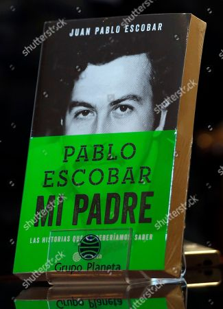 Juan Pablo Escobar, Sebastian Marroquin A book written by Juan Pablo Escobar, the son of Colombia's late drug lord Pablo Escobar, stands on a table during an interview with the author in Bogota, Colombia, . Escobar, who legally changed his name to Sebastian Marroquin and moved to Argentina in 1994 with his mother Maria Valeria Henao after his father was killed, is in Colombia to launch his book: Pablo Escobar My Father