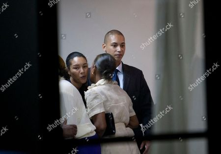 "Francois-Nicolas, Anya Duvalier Francois-Nicolas, right, and Anya Duvalier, left, son and daughter of former Haitian dictator Jean-Claude ""Baby Doc"" Duvalier, greet friends and family during their father's wake in Port-au-Prince, Haiti, . Jean-Claude ""Baby Doc"" Duvalier, the self-designated ""president-for-life"" who died Saturday from an apparent heart attack, will not get a formal state funeral, his attorney said Thursday"