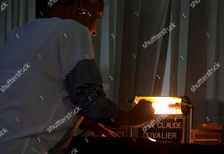 "A visitor signs the registry during the wake for former Haitian dictator Jean-Claude ""Baby Doc"" Duvalier, in Port-au-Prince, Haiti, . Jean-Claude ""Baby Doc"" Duvalier, the self-designated ""president-for-life"" who died Saturday from an apparent heart attack, will not get a formal state funeral, his attorney said Thursday"
