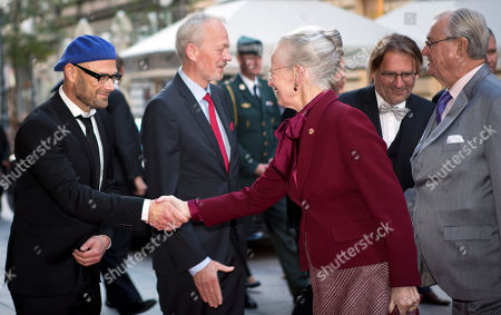 Queen Margrethe II, Prince Henrik, Ole Christian Madsen Danish queen Margrethe II, center, shakes hands with Ole Christian Madsen a Danish film director and script writer, as she and Prince Henrik, right, arrive for a screening at a film festival in Zagreb, Croatia, . The Danish royal couple is on a state visit to Croatia