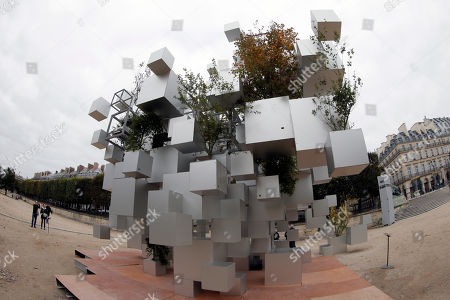 With a fisheye lens, Many Small Cubes by Japanese architect Sou Fujimoto is displayed in the Tuileries Garden of the Louvre Museum as part of the FIAC, the International Fair of Contemporary Art, in Paris, . The fair opens Oct. 23 and ends on Oct. 26